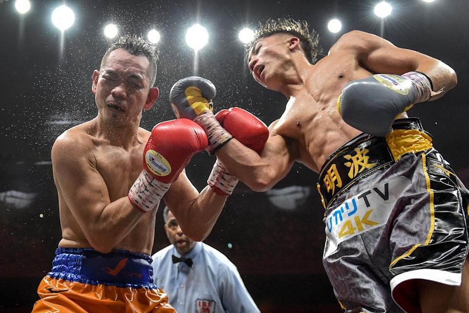 Naoya Inoue of Japan (R) and Nonito Donaire of Philippines (L) fight in their World Boxing Super Series bantamweight final at Saitama Super Arena in Saitama on November 7, 2019. (Photo by Kazuhiro NOGI / AFP) (Photo by KAZUHIRO NOGI/AFP via Getty Images)