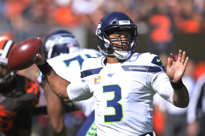 Seattle Seahawks quarterback Russell Wilson looks to pass during the first half of an NFL football game against the Cleveland Browns, Sunday, Oct. 13, 2019, in Cleveland. (AP Photo/David Richard)