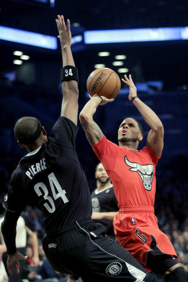Chicago Bulls' D.J. Augustin, right, is fouled by Brooklyn Nets' Paul Pierce during the first half of the NBA basketball game at the Barclays Center Wednesday, Dec. 25, 2013, in New York. (AP Photo/Seth Wenig)