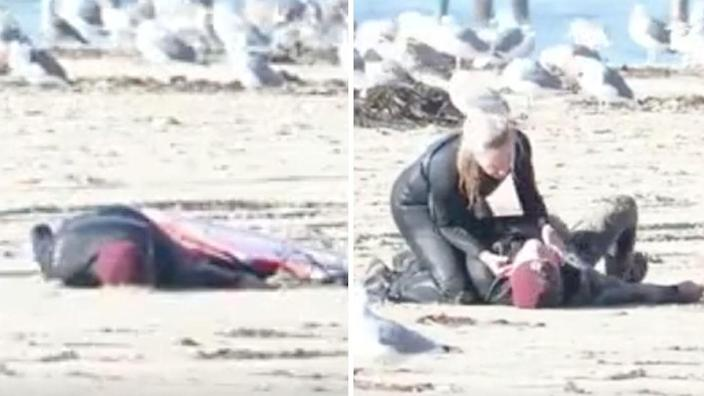 Andi Traynor gives Max Montgomery CPR after he collapses on the beach in Capitola. Source: Paddle4Good/Alexander Baker