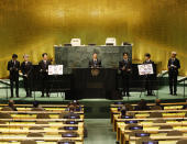 ADDS IDS- Members of South Korean K-pop band BTS, from left, V, Suga, Jin, RM, Jung Kook, Jimin and J-Hope appear at the Sustainable Development Goals meeting during the 76th session of the United Nations General Assembly, at the United Nations Headquarters on Monday, Sept. 20, 2021. In his General Assembly opening address on Tuesday, U.N. Secretary-General Antonio Guterres practically scolded world leaders for disappointing young people with a perceived inaction on climate change, inequalities and the lack of educational opportunities, among other issues important to young people. (John Angelillo/Pool via AP)