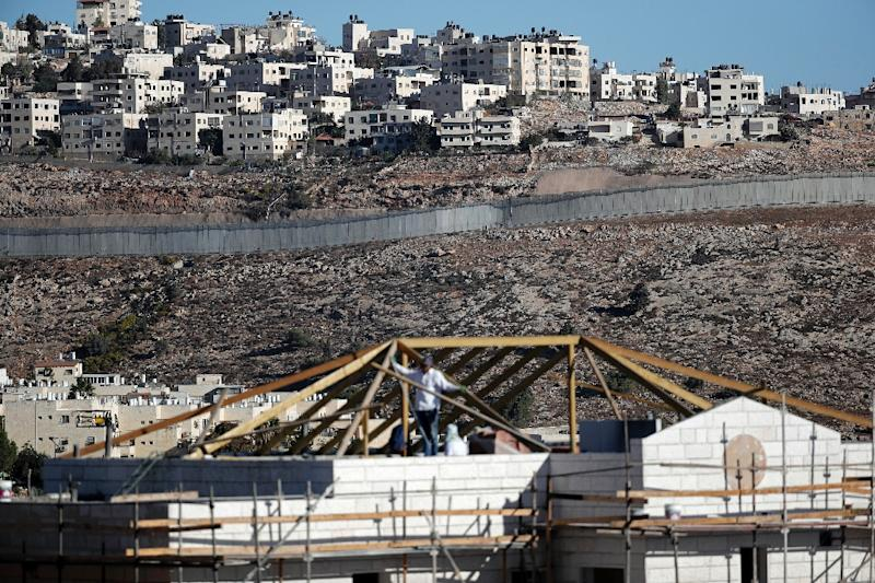 Buildings are seen under construction in the Israeli settlement of Pisgat Zeev in front of the Israeli barrier separating Jerusalem and the West Bank city of Ramallah