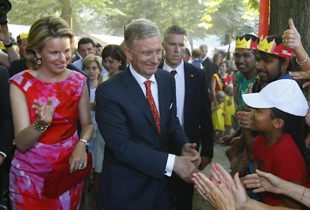 Belgium's Queen Mathilde, left, and King Philippe greet the public in the Parc Royale in Brussels on Sunday, July 21, 2013. Belgium's Prince Philippe has taken the oath before parliament to become Belgium's seventh king after his father Albert II abdicated as the head of this fractured nation. Earlier Sunday, the 79-year-old Albert signed away his rights as the kingdom's largely ceremonial ruler at the royal palace in the presence of Prime Minister Elio Di Rupo, who holds the political power in this 183-year-old parliamentary democracy. (AP Photo/Yves Herman, Pool)