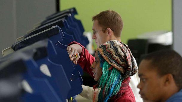 PHOTO: Voters cast their ballot during early voting at a polling station in Chicago, Oct. 31, 2016. (Joshua Lott/AFP via Getty Images)