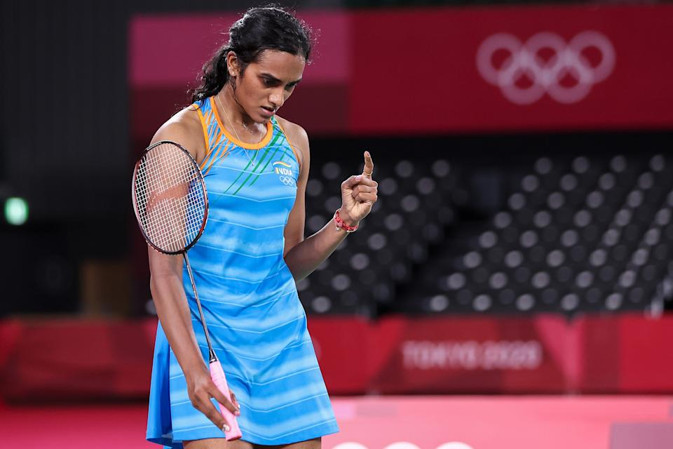 CHOFU, JAPAN - AUGUST 01: Pusarla V. Sindhu of Team India celebrates as she wins against He Bing Jiao of Team China during the Women's Singles Bronze Medal match on day nine of the Tokyo 2020 Olympic Games at Musashino Forest Sport Plaza on August 01, 2021 in Chofu, Tokyo, Japan. (Photo by Lintao Zhang/Getty Images)