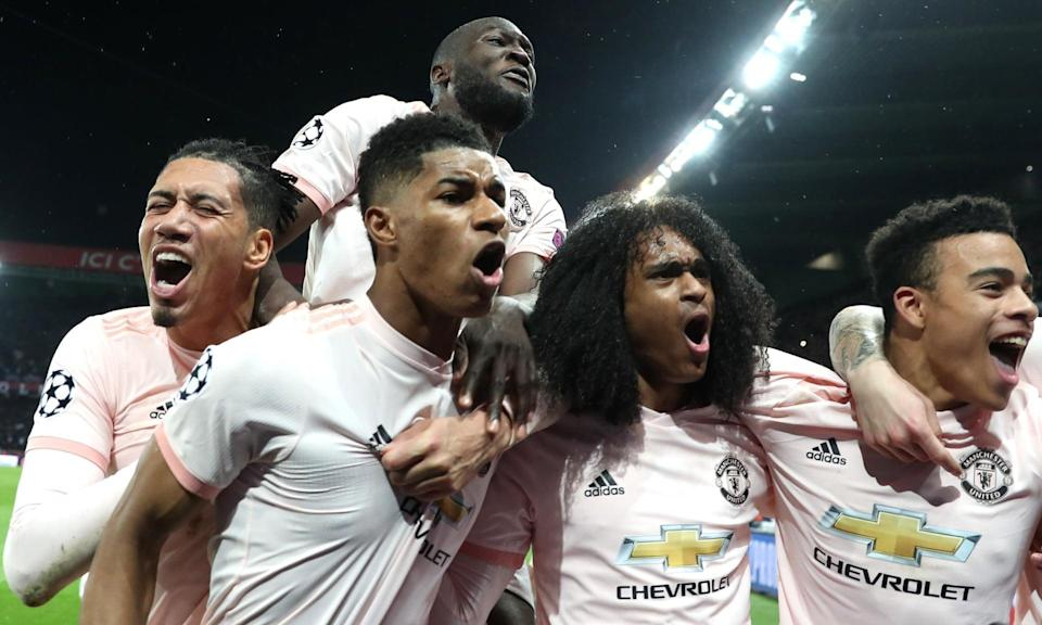 "<a class=""link rapid-noclick-resp"" href=""/soccer/teams/manchester-united/"" data-ylk=""slk:Manchester United"">Manchester United</a> celebrates with Marcus Rashford (center) after he scored the winning goal to beat Paris Saint-Germain in the Champions League on Wednesday. (The Mundial Group)"