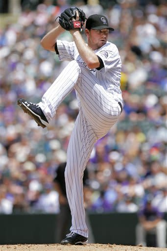 Colorado Rockies starting pitcher Alex White (6) challenges Los Angeles Dodgers' Dee Gordon during the first inning of a baseball game, Sunday, June 3, 2012, in Denver. (AP Photo/Barry Gutierrez)