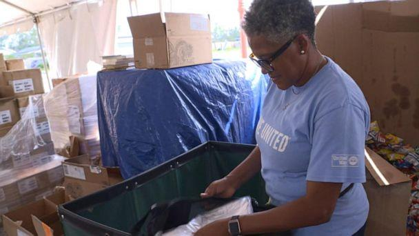 PHOTO: A volunteer helps prepare items for residents in need after the hurricanes in Louisiana. (ABC News)