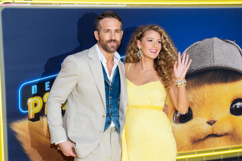 Blake Lively and Ryan Reynolds have shared the first image of their third baby, snuggled in a baby carrier. The couple revealed their pregnancy news back in May [Photo: Getty]