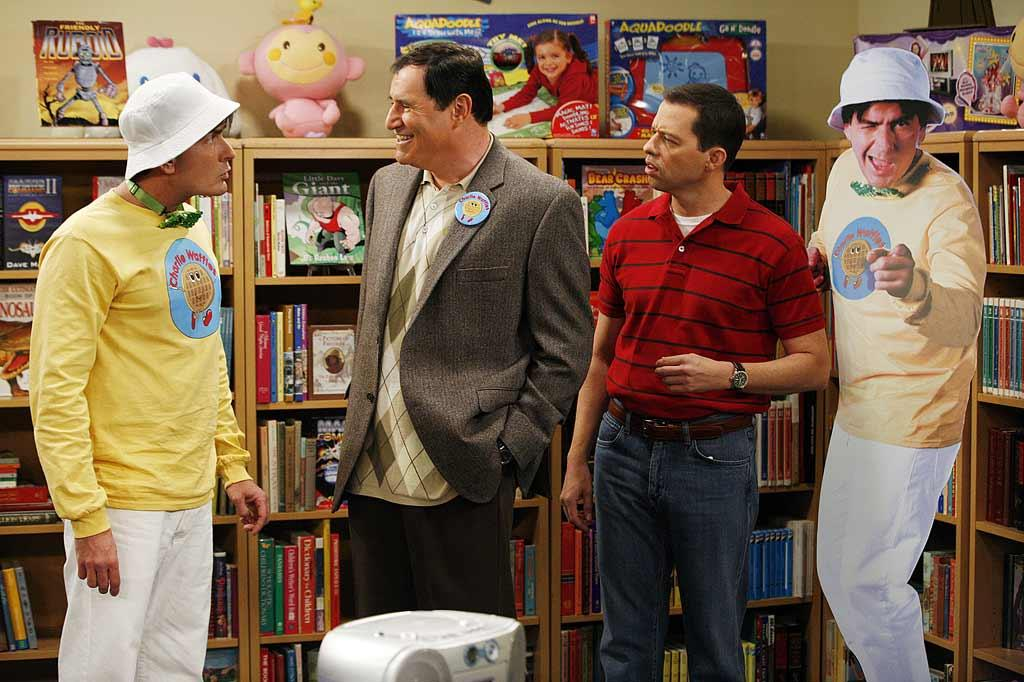 Charlie (Charlie Sheen, left) finds success as a children's singing star, which makes his record label executive, Artie (special guest star Richard Kind, right) happy, but his brother Alan (Jon Cryer, center) miserable, on Two and a Half Men.