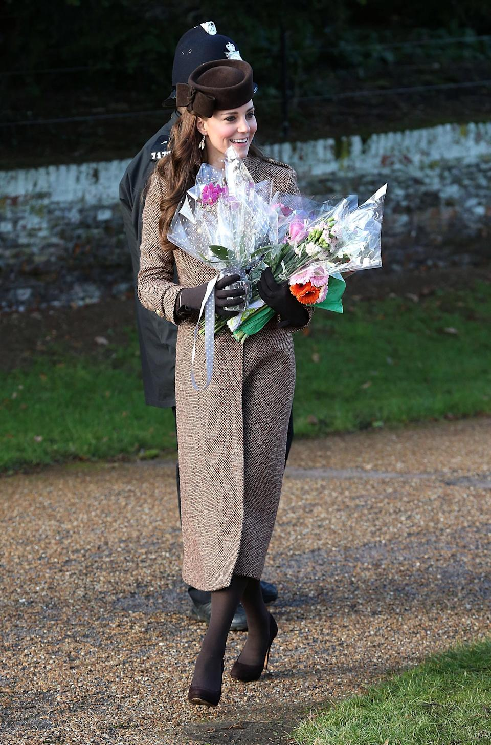 The Duchess of Cambridge was laden-down with flowers when she showed up at church in 2014. Photo: Getty Images