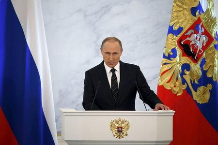 Russian President Putin addresses the Federal Assembly, including State Duma deputies, members of the Federation Council, regional governors and civil society representatives, at the Kremlin in Moscow