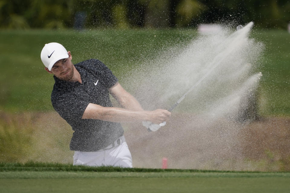 Aaron Wise hits from the sand on the third hole during the third round of the Honda Classic golf tournament, Saturday, March 20, 2021, in Palm Beach Gardens, Fla. (AP Photo/Marta Lavandier)