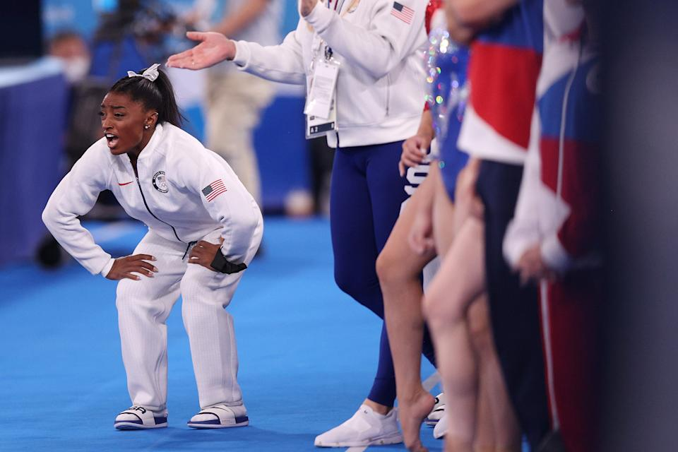 <p>TOKYO, JAPAN - JULY 27: Simone Biles of Team United States cheers during the Women's Team Final on day four of the Tokyo 2020 Olympic Games at Ariake Gymnastics Centre on July 27, 2021 in Tokyo, Japan. (Photo by Ezra Shaw/Getty Images)</p>