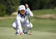 Jin Young Ko, of South Korea, lines up her putt on the 12th green during the final round of the LPGA Volunteers of America Classic golf tournament in The Colony, Texas, Sunday, July 4, 2021. (AP Photo/Ray Carlin)