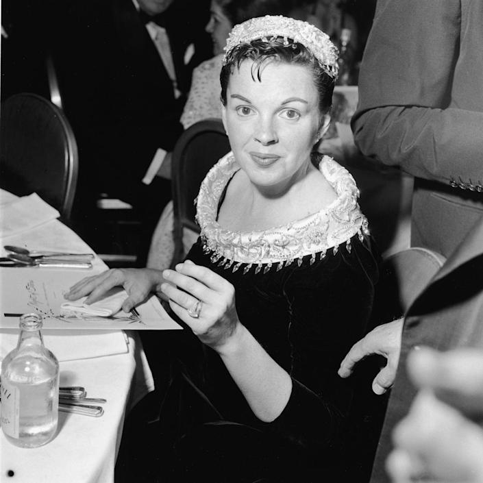 "<p>Judy returned to the movie industry, starring in <u><a href=""https://www.amazon.com/Star-Born-Judy-Garland/dp/B003RMH33K/ref=tmm_aiv_swatch_1?_encoding=UTF8&qid=1562450693&sr=8-9&tag=syn-yahoo-20&ascsubtag=%5Bartid%7C10050.g.28612488%5Bsrc%7Cyahoo-us"" rel=""nofollow noopener"" target=""_blank"" data-ylk=""slk:A Star Is Born"" class=""link rapid-noclick-resp""><em>A Star Is Born</em></a></u>, opposite James Mason. Luft had been instrumental in putting together the film. She was nominated for an Academy Award, though she lost to Grace Kelly. Here, she's at the premiere. </p>"