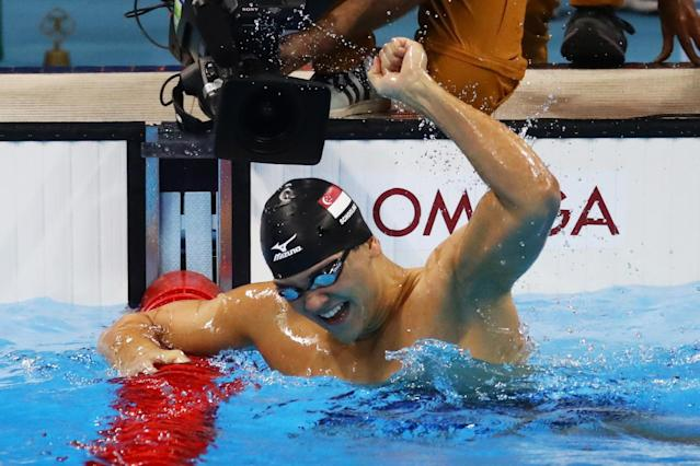 <p>Joseph Schooling of Singapore celebrates winning gold in the Men's 100m Butterfly Final on Day 7 of the Rio 2016 Olympic Games at the Olympic Aquatics Stadium on August 12, 2016 in Rio de Janeiro, Brazil. (Photo by Dean Mouhtaropoulos/Getty Images) </p>