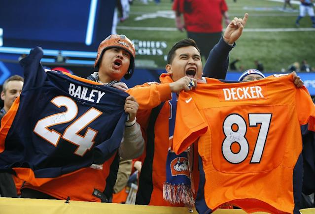 Denver Broncos fans cheer at MetLife Stadium before the NFL Super Bowl XLVIII football game between the Seattle Seahawks and the Broncos Sunday, Feb. 2, 2014, in East Rutherford, N.J. (AP Photo/Evan Vucci)