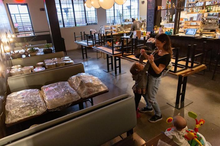 Owner Caitlin Cutler plays with her children at Ronan, shortly after the March shutdown last year.