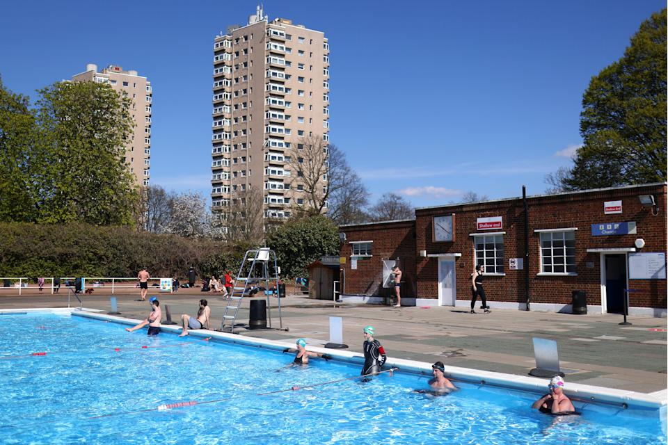 Cold water swimmers observe a minute's silence at the Brockwell Lido in LondonREUTERS