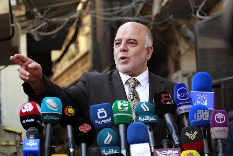 Iraqi Prime Minister Haider al-Abadi gives a press conference on October 20, 2014 in the Iraqi central shrine city of Najaf (AFP Photo/Haidar Hamdani)