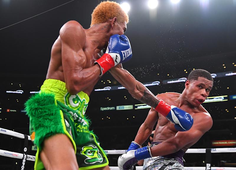 LOS ANGELES, CA - NOVEMBER 09: Devan Haney (silver shorts) and Alfredo Santiago-Alvarez (green shorts) exchange punches during their WBC World Lightweight Championship fight at Staples Center on November 9, 2019 in Los Angeles, California. Haney won by unanimous decision. (Photo by Jayne Kamin-Oncea/Getty Images)