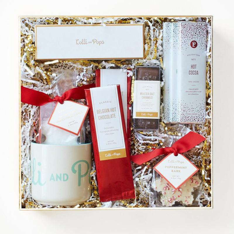 """<p>Send a box of specialized chocolates, caramels, peppermints, cocoa, and more treats from <a rel=""""nofollow noopener"""" href=""""https://www.lolliandpops.com/"""" target=""""_blank"""" data-ylk=""""slk:Lolli & Pops"""" class=""""link rapid-noclick-resp"""">Lolli & Pops</a>. They're perfect for cozying up and relaxing with some holiday movies.</p><p>Buy it <a rel=""""nofollow noopener"""" href=""""https://www.lolliandpops.com/products/holly-jolly"""" target=""""_blank"""" data-ylk=""""slk:here"""" class=""""link rapid-noclick-resp"""">here</a> for $59.</p>"""
