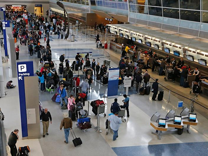 Passengers waiting to speak with ticket agents at American Airlines line the length of Terminal D at DFW International Airport December 6, 2013 in Dallas, Texas.