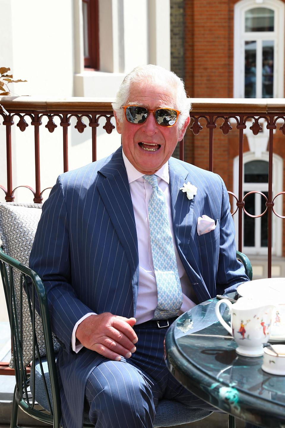 Britain's Prince Charles, Prince of Wales takes tea on the terrace during a visit to the Theatre Royal Drury Lane following its refurbishment in London on June 23, 2021. (Photo by Tim P. Whitby / POOL / AFP) (Photo by TIM P. WHITBY/POOL/AFP via Getty Images)