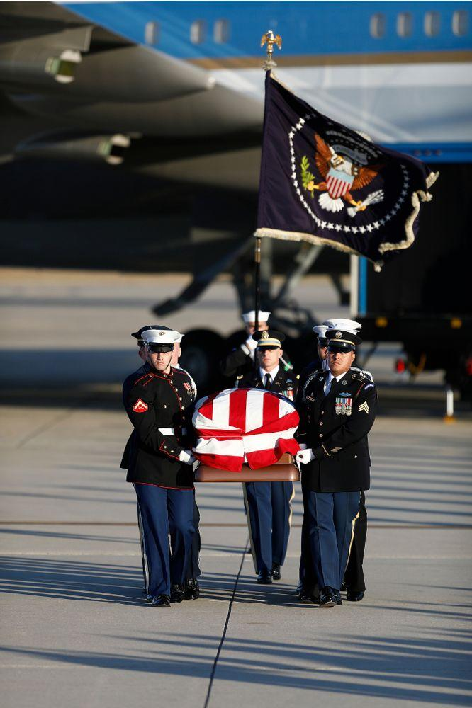 Joint service members of a military casket team carry the casket of former President George H. W. Bush