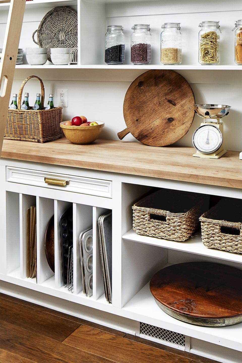 <p>Some kitchen items, like cutting boards and baking pans, are best kept upright, whether for visual appeal or to make them easy to grab.</p>