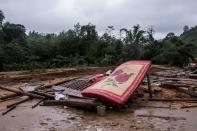 The house of villager Ho Van Suot is seen after it was destroyed by a landslide in Quang Tri province
