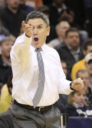 Akron head coach Keith Dambrot reacts in the second half of an NCAA college basketball game against Kent State in the Mid-American Conference men's semifinals on Friday, March 9, 2012, in Cleveland. Akron won 78-74. (AP Photo/Tony Dejak)