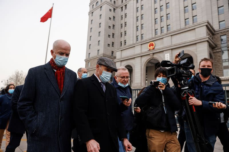 Klein, acting deputy chief of mission of the U.S. Embassy in Beijing, and Nickel, charge d'affaires of the Canadian Embassy in Beijing, walk beside members of the media outside Beijing No. 2 Intermediate People's Court