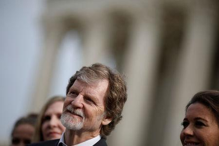 FILE PHOTO: Baker Jack Phillips speaks with the media following oral arguments in the Masterpiece Cakeshop vs. Colorado Civil Rights Commission case at the Supreme Court in Washington, U.S., December 5, 2017. REUTERS/Aaron P. Bernstein/File Photo