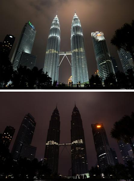 This combination of pictures created on March 19, 2016 shows the Petronas towers before (top) and after the lights were switched off (bottom) during the Earth Hour campaign in Kuala Lumpur on March 19, 2016