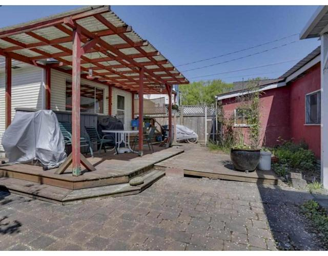 """<p><a href=""""https://www.zoocasa.com/richmond-bc-real-estate/5260954-100-wellington-crescent-richmond-bc-v7b1g5-r2262853"""" rel=""""nofollow noopener"""" target=""""_blank"""" data-ylk=""""slk:100 Wellington Cres., Richmond, B.C."""" class=""""link rapid-noclick-resp"""">100 Wellington Cres., Richmond, B.C.</a><br> The lot has back lane access, and is a five-minute commute to Vancouver.<br> (Photo: Zoocasa) </p>"""
