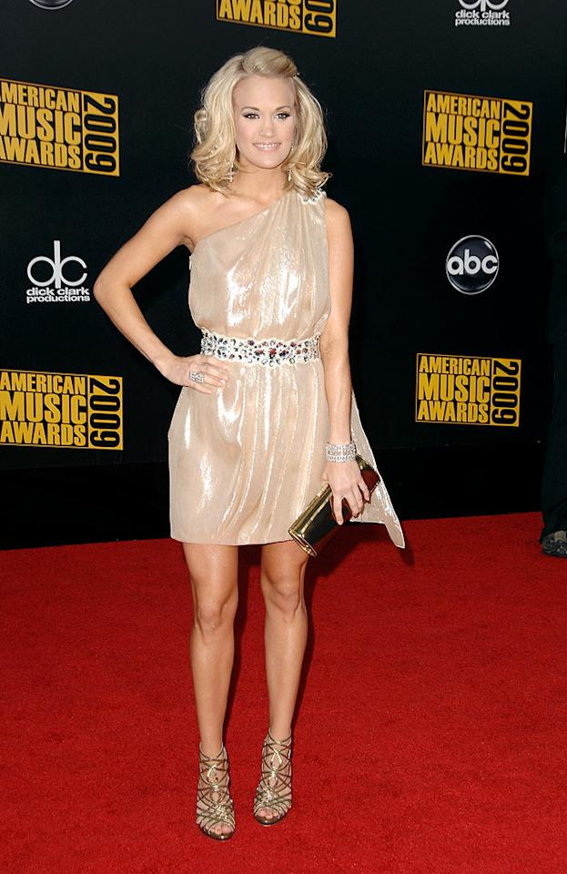 "Carrie Underwood  Grade: A  The perky country singer worked the red carpet in a champagne one-shoulder mini, gold strappy sandals, and a bouncy new' do. Steve Granitz/<a href=""http://www.wireimage.com"" target=""new"">WireImage.com</a> - November 22, 2009"