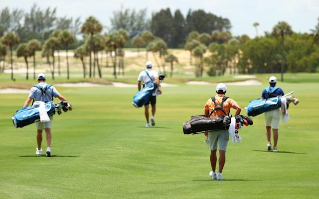 With caddies not allowed due to social distance rules, players had to carry their own bags - GETTY IMAGES