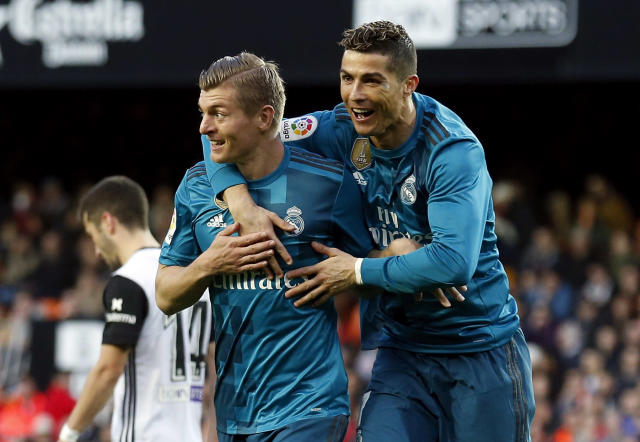 "<a class=""link rapid-noclick-resp"" href=""/soccer/players/toni-kroos/"" data-ylk=""slk:Toni Kroos"">Toni Kroos</a> and <a class=""link rapid-noclick-resp"" href=""/soccer/players/cristiano-ronaldo/"" data-ylk=""slk:Cristiano Ronaldo"">Cristiano Ronaldo</a> celebrate one of <a class=""link rapid-noclick-resp"" href=""/soccer/teams/real-madrid/"" data-ylk=""slk:Real Madrid"">Real Madrid</a>'s four goals at Valencia on Saturday. (Getty)"