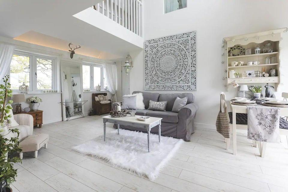 "<p>This detached cottage near the village of Wybunbury offers far-reaching rural views and calming decor. You'll find grey and ivory hues throughout the Airbnb cottage and patio doors leading onto a south-facing balcony so you can take in the surroundings. The duplex apartment comes with modern essentials, including Netflix, and open-plan living and dining.</p><p><strong>Sleeps:</strong> 4</p><p><strong>Price per night:</strong> £120</p><p><a class=""link rapid-noclick-resp"" href=""https://airbnb.pvxt.net/5bgDkb"" rel=""nofollow noopener"" target=""_blank"" data-ylk=""slk:SEE INSIDE"">SEE INSIDE</a></p>"