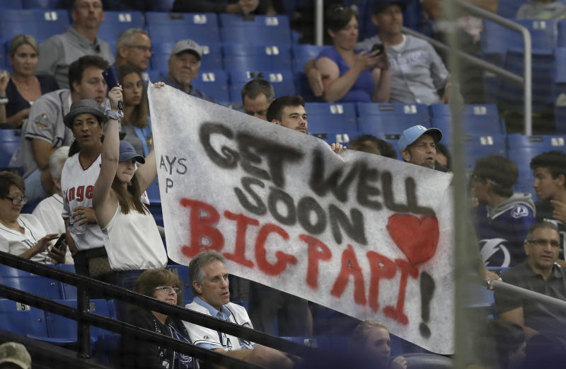 Tampa Bay Rays fans hold up a sign with encouraging words for former Boston Red Sox player David Ortiz during the seventh inning of the Rays' baseball game against the Los Angeles Angels on Thursday, June 13, 2019, in St. Petersburg, Fla. Ortiz was injured in a shooting earlier this week in the Dominican Republic. (AP Photo/Chris O'Meara)