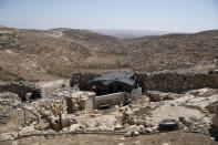A stockyard that suffered damage following a settlers' attack from nearby settlement outposts on the Bedouin community, in the West Bank village of al-Mufagara, near Hebron, Thursday, Sept. 30, 2021. An Israeli settler attack last week damaged much of the village's fragile infrastructure. (AP Photo/Nasser Nasser)