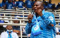 Central African Republic President Faustin Archange Touadera addresses supporters at a political rally at the stadium in Bangui