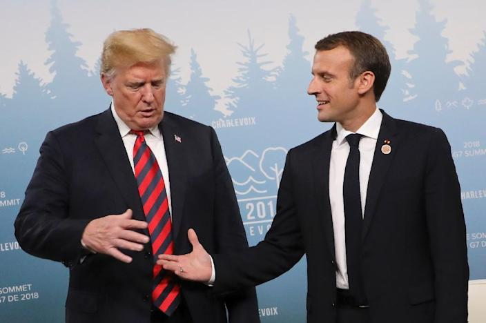 Trump cautiously accepts a handshake from France's Macron (AFP Photo/Ludovic MARIN)