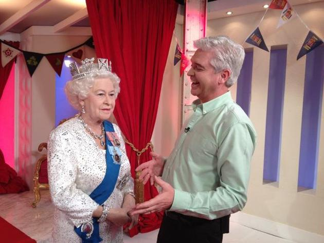 "Celebrity photos: When a waxwork of the Queen arrived at the This Morning studios, Phillip Schofield couldn't resist the opportunity to pose for a funny Twitpic. Phillip posted this photo with the caption: ""It was a very proud moment to welcome The Queen to the studio. Here we are sharing a joke :)"" [sic]"