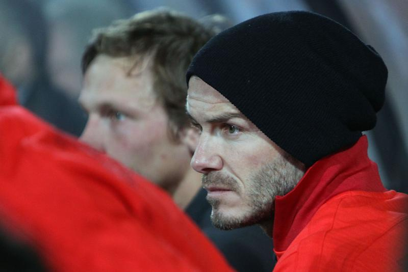 English midfielder David Beckham of Paris Saint Germain looks on on the bench during his French League One soccer match against Lorient, Sunday, May 26, 2013 in Lorient, western France. Beckham play officially his last game tonight as a professional player. (AP Photo/David Vincent)