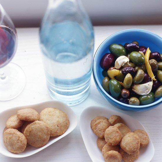 "<p>Chef Marc Murphy serves these olives warm to accentuate the marinade's lemony flavor.</p><p><a href=""https://www.foodandwine.com/recipes/warm-olives-rosemary-garlic-and-lemon"">GO TO RECIPE</a></p>"