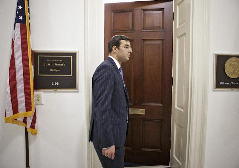 Rep. Justin Amash, R-Mich. returns to his office on Capitol Hill in Washington, Wednesday, July 24, 2013, after a meeting with constituents, before the vote on the Defense spending bill in the House containing his amendment to cut funding to the National Security Agency's program that collects phone records. The White House and congressional backers of the NSA's electronic surveillance program are warning that ending the massive collection of phone records from millions of Americans would put the nation at risk from another terrorist attack. (AP Photo/J. Scott Applewhite)