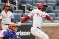 Philadelphia Phillies' Didi Gregorius follows though on an RBI single during the eighth inning of a baseball game against the New York Mets in the first game of a doubleheader Tuesday, April 13, 2021, in New York. (AP Photo/Frank Franklin II)